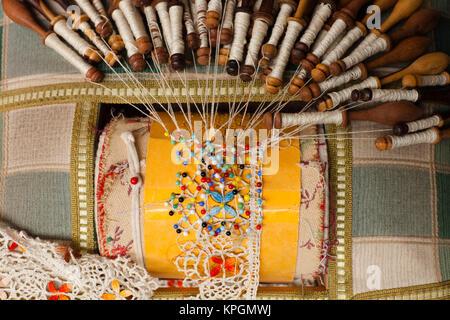 France, Haute-Loire Department, Auvergne Region, Le Puy-en-Velay, lace-making detail - Stock Photo