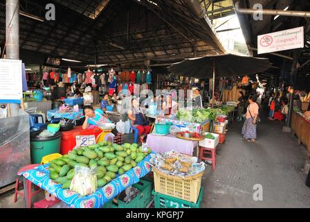 Market and grocery stalls commonly found in Thailand and other Asian countries selling various food ingredients - Stock Photo