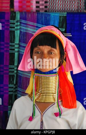 Portrait of elderly long necked Karen tribeswoman in traditional costume. - Stock Photo