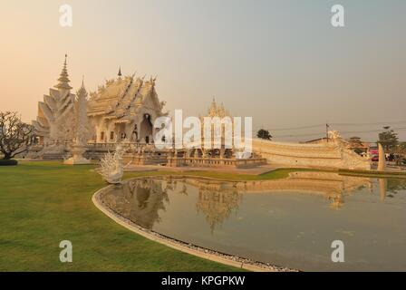 Famous Wat Rong Khun Buddhist and Hindu temple in Chiang Rai, Thailand. - Stock Photo
