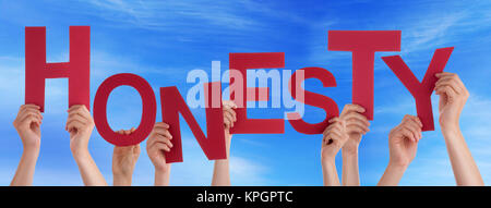 Many Caucasian People And Hands Holding Red Letters Or Characters Building The English Word Honesty On Blue Sky - Stock Photo