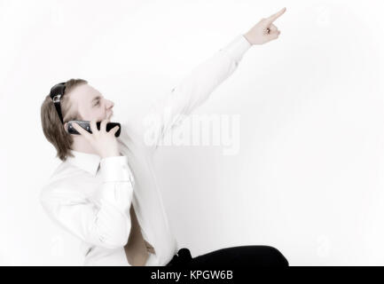 Model released , Schreiender, junger Gesch?ftsmann mit Handy - young businessman with mobile phone - Stock Photo