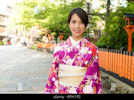 Asian Woman with kimono dress in gion - Stock Photo