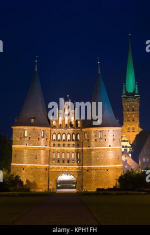Germany, Schleswig-Holstein, Lubeck. Holstentor city gate. - Stock Photo