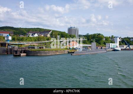 British submarin HMS Otus at harbour, used as museum, behind hotel Ruegen and pedestrian bridge, Sassnitz, Ruegen - Stock Photo