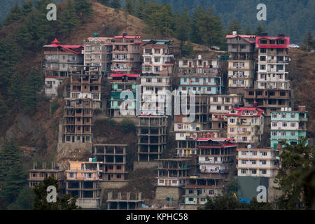 Apartment building housing on hillside in Shimla, Himachal Pradesh, India - Stock Photo