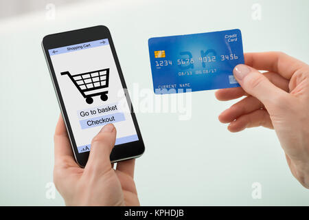 Businesswoman Hand Holding Credit Card And Mobile Phone - Stock Photo