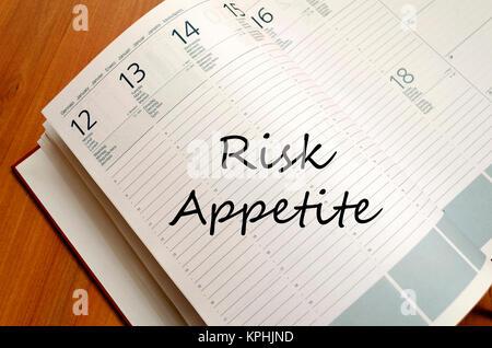 Risk appetite write on notebook - Stock Photo