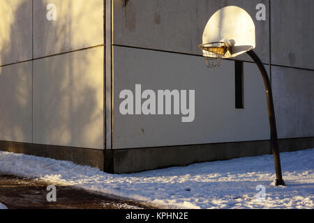 basketball backboard and hoop in the urban area - Stock Photo