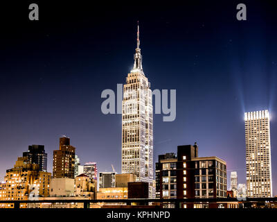 NEW YORK, USA - JANUARY 5, 2015: The Empire State Building seen through the Manhattan Bridge in the afternoon. The - Stock Photo