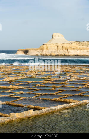 Salt Pans on the coast at Qbajjar  near Marsalforn Bay Bay Gozo Malta - Stock Photo