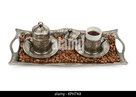 Turkish cup and coffee grain isolated on white background - Stock Photo