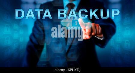 Corporate Computer User Touching DATA BACKUP - Stock Photo