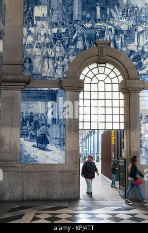 Traditional dececorated tiles ,azulejos, in Sao Bento railway station at Porto, Portugal - Stock Photo