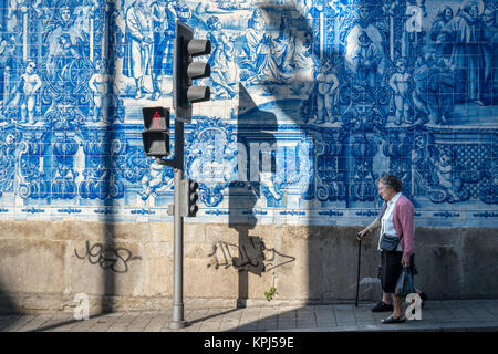 Traditional, blue glazed, dececorated tiles, azulejos,on the exterior of Capela das Almas church, in the centre - Stock Photo