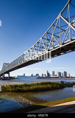 USA, Louisiana, New Orleans. Skyline from the Greater New Orleans Bridge and Mississippi River, late afternoon. - Stock Photo