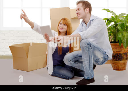 Happy couple planning decor in new home - Stock Photo