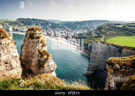 view from the famous white cliffs of etretat on the beach and the place - Stock Photo