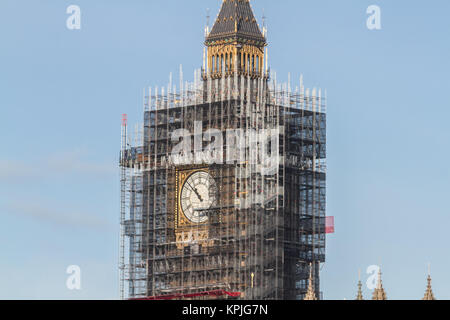 London UK. 16th December 2017. The Palace of Westminster and Elizabeth tower covered in scaffolding under clear - Stock Photo