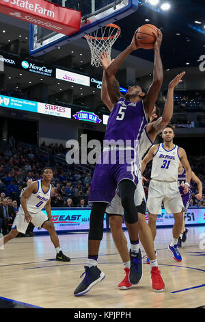Saturday Dec 16th - Northwestern Wildcats center Dererk Pardon (5) puts up a shot underneath the basket during NCAA Mens basketball game action between the Northwestern Wildcats and the DePaul Blue Demons at the Windtrust Arena in Chicago, IL.