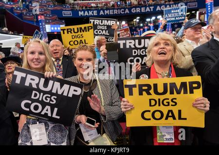 Coal supporters hold up signs that say Trump Digs Coal during an address on coal during the second day of the Republican - Stock Photo