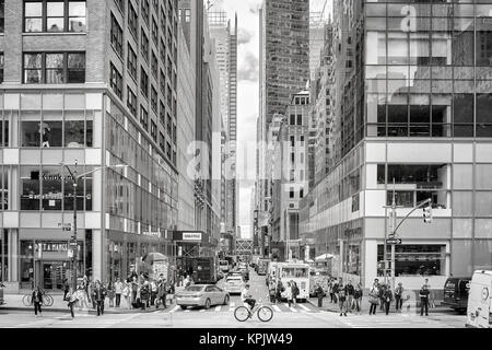 New York City, USA - May 26, 2017: Crowded pedestrian crossing at 6th Avenue during the afternoon rush hour. - Stock Photo