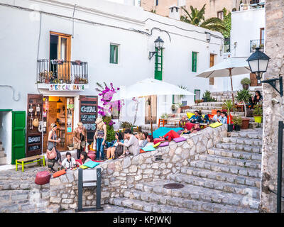 IBIZA, SPAIN - MAY 23, 2015. The Ibiza culture means to enjoy the life in the clubs and bars. - Stock Photo