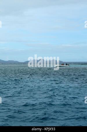Boat in sea off the coast of Felicite Island, Seychelles. - Stock Photo