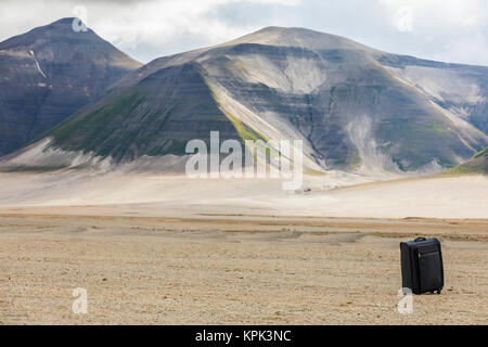 A piece of luggage sits isolated in the empty Valley of Ten Thousand Smokes in Katmai National Park; Alaska, United - Stock Photo