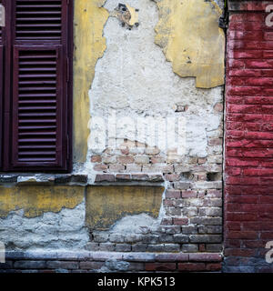 Architectural detail of a brick wall that is worn and weathered, crumbling and cracked; Belgrade, Vojvodina, Serbia - Stock Photo