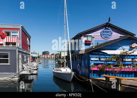 Shops and homes in Fisherman's Wharf in the Inner Harbour of Victoria, Vancouver Island; Victoria, British Columbia, - Stock Photo