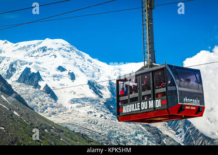Mont Blanc and Aiguille du Midi Cable Car under blue sky, viewed from Plan de l'Aiguille; Chamonix-Mont-Blanc, Haute - Stock Photo