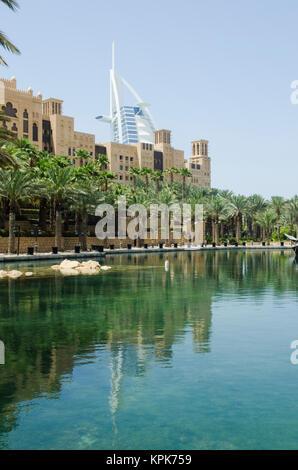 Burj Al Arab Hotel with the Old Town Palace hotel Dubai - Stock Photo