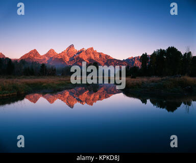 USA, Wyoming, Grand Teton National Park, Teton Range reflecting in Beaver Pond at sunrise (Large format sizes available) - Stock Photo