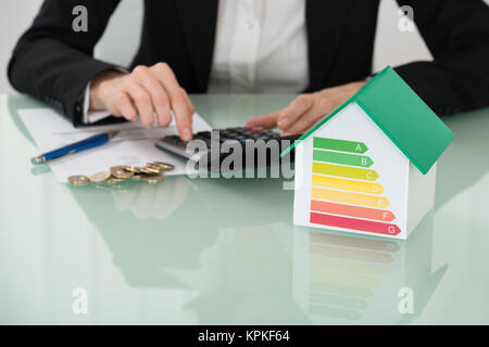 Invoice With Euro Coins And Energy Efficiency Rate On Desk - Stock Photo