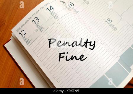 Penalty fine write on notebook - Stock Photo