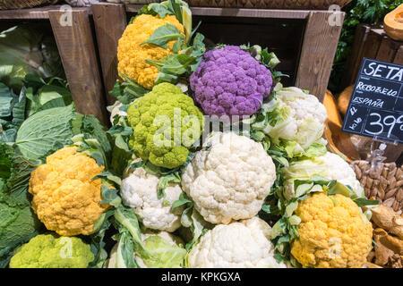 Multi-coloured cauliflowers in a Spanish supermarket. Purple, yellow, green and white - Stock Photo