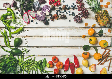 Flat-lay of fresh fruit, vegetables, greens and superfoods - Stock Photo