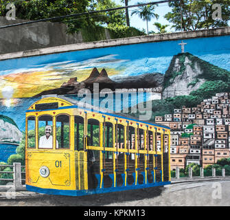 Colorful street art depicting a bond tram driving above the city skyline, Rio de Janeiro, Brazil - Stock Photo