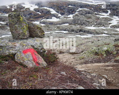 Cairn used as Trolltunga (Troll tongue) trail marker - Stock Photo