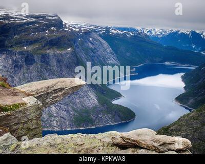The rock formation Trolltunga (Troll tongue), Odda, Norway - Stock Photo