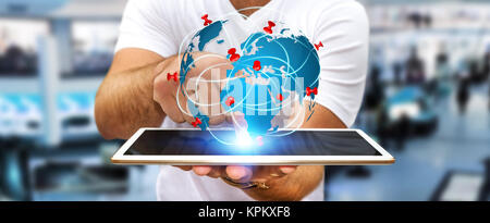Businessman holding digital world map in his hands - Stock Photo