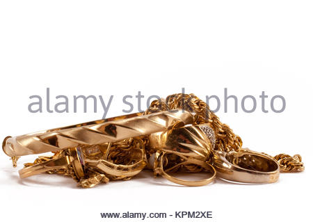 scrap gold jewellery including chains, bracelets and rings on a white background - Stock Photo