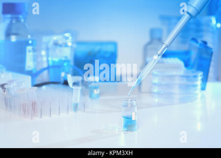 Scientific background in blue and white. Liquid sample loading with automatic pipette, space for your text. This - Stock Photo
