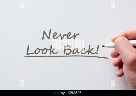 Never look back written on whiteboard - Stock Photo