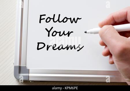 Follow your dreams written on whiteboard - Stock Photo