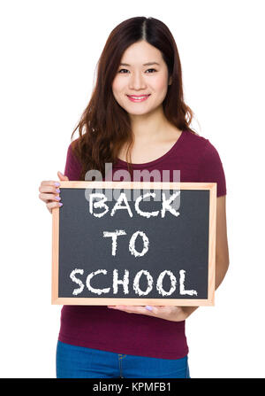Asian Young woman hold with chalkboard and showing phrase of back to school - Stock Photo