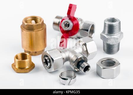 closeup of plumbing equipment isolated on white - Stock Photo