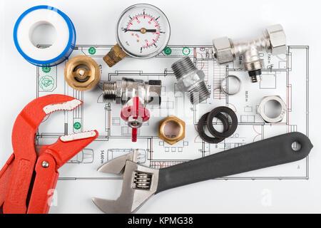 plumbing tools and equipment on blueprint - Stock Photo