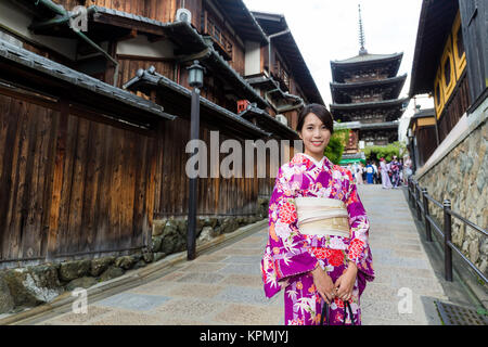 Asian Woman dress up with kimono in yasaka pagoda - Stock Photo